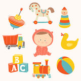 Baby girl with toys : ball, blocks, rubber duck, rocking horse, toy train, pyramid, spinning top, toy truck. Stock Photo