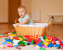 Baby girl  with toys. Year-old child with toys on the floor Royalty Free Stock Photo