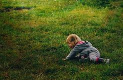 Child falled down in park royalty free stock photo