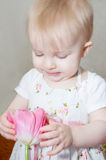Baby girl with tulip Stock Photos