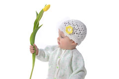 Baby girl  with tulip Royalty Free Stock Images