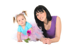 Baby girl in tutu holding hands tulip for Mom Stock Image