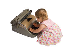 Baby Girl with Typewriter Royalty Free Stock Photography