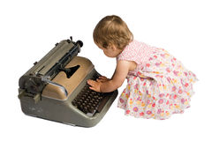 Baby Girl Typing on a Typewriter Royalty Free Stock Photo