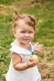 Baby girl under the apple tree stock photos