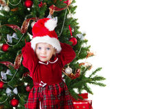 Baby girl under the Christmas tree Stock Image