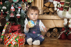 Baby girl under the Christmas tree Royalty Free Stock Image
