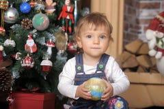 Baby girl under the Christmas tree Stock Photo