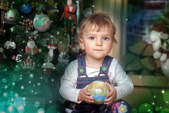Baby girl under the Christmas tree Royalty Free Stock Photo