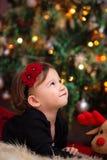 Baby Girl Under Christmas Tree Stock Photography