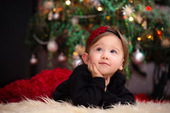 Baby Girl Under Christmas Tree Royalty Free Stock Photography