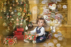 Baby girl under the Christmas tree Royalty Free Stock Images