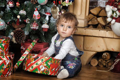 Baby girl under the Christmas tree Stock Photos