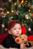 Baby Girl Under Christmas Tree Stock Images