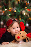 Baby Girl Under Christmas Tree Stock Photography