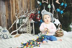Baby girl under Christmas tree Stock Photo