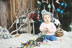 Baby girl under Christmas tree Stock Photo
