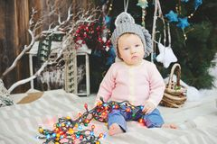 Baby girl under Christmas tree Royalty Free Stock Photos
