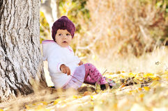 Baby girl under the tree Royalty Free Stock Photo