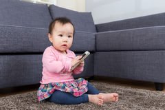 Baby girl use mobile Stock Images