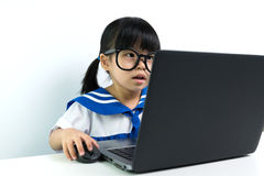 Baby girl using laptop Royalty Free Stock Image