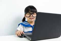 Baby girl using laptop Stock Images