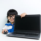 Baby girl using laptop Royalty Free Stock Photography