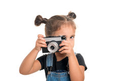 Baby girl  with vintage camera  posing  in studio.Isolated Stock Photography
