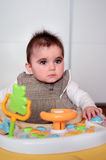 Baby girl  in a walker. Cute baby girl playing in her walker Royalty Free Stock Photo