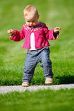 Baby girl walking Stock Images