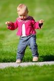 Baby girl walking stock images