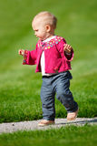 Baby girl walking Royalty Free Stock Photos