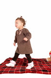 Baby girl walking away, Royalty Free Stock Photography