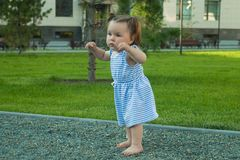 Baby girl walking by stones, prevention of flatfoot in children walking on the textured surface. Baby girl walking by stones, prevention of flatfoot in children stock photos