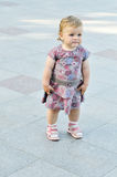 Baby girl wants to walk Stock Image