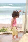 Baby girl washing his feet Royalty Free Stock Image