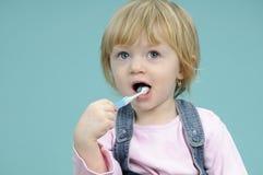 Baby girl washing teeth Stock Image