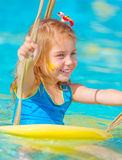 Baby girl in water park Royalty Free Stock Image
