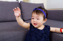Baby girl waving hand Royalty Free Stock Images