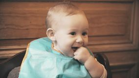 Baby girl wearing bib smiles, close-up stock photography
