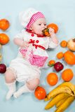 Baby girl  wearing a chef hat with fruits Stock Image