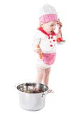 Baby girl wearing a chef hat with vegetables and pan isolated on white background. Stock Images