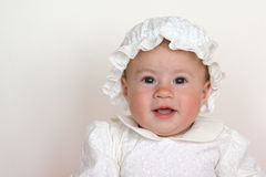 Baby girl wearing christening dress Royalty Free Stock Photography