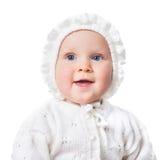 Baby girl wearing crochet bonnet isolated Stock Photo