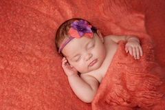 Baby Girl Wearing a Flower Headband stock images
