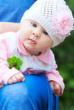 Baby Girl Wearing Knit Hat with pink Flower. Baby girl in cute white hat with pink flower Royalty Free Stock Photography