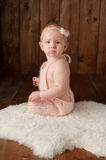 Baby Girl Wearing a Knitted Romper and Headband Royalty Free Stock Photo
