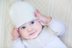 Baby girl wearing knitted sweater and hat Stock Images