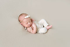 Baby girl wearing lovely costume sleeping Royalty Free Stock Photography