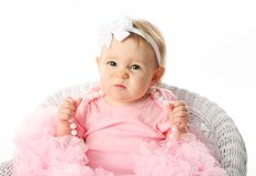 Baby girl wearing pettiskirt tutu and pearls Stock Photo